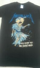 "Metallica "" Their Money tips her scales again "" size Small. Black t shirt."