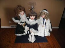 Set of 3 Porcelain doll Christmas Carolers with lighted lamp post