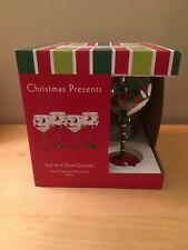 4 WINE GLASSES, CHRISTMAS, HAND PAINTED. SUSAN WINGET, IN ORIGINAL BOX