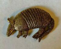 Vintage 1980 COPYRIGHTED large ARMADILLO gold-like metal badge