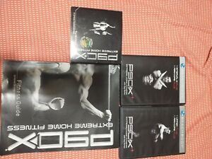P90x Complete DVD Set plus 3 extra DVDs and workout book