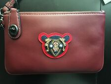 NWT Coach TURNLOCK wristlet 21 in varsity patches leather BLACK COPPER/BORDEAUX