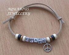 PEACE FRIENDSHIP BRACELET WOODEN BEADS/SMALLPEACE CHARM ON A BEIGE SUEDE CORD