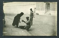 C1910-20 MALTA - MAN SELLING A LADY SOME VEGETABLES IN THE STREET (?)
