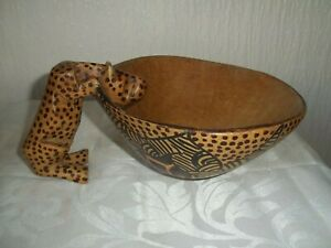 HAND CARVED WOODEN BOWL WITH LEOPARD ON THE SIDE AND PATTERN ON THE BASE