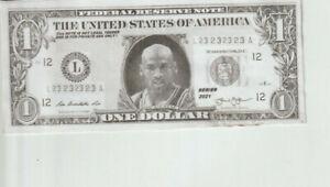 Michael Jordan $1 Trick Novelty Bill front when Held in Light displays A Jordan.