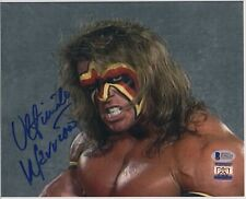 ULTIMATE WARRIOR signed WWF WWE 8x10 photo AUTOGRAPH auto Beckett BAS Hogan RIP