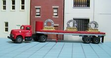 HO scale tractor trailer CMW, P-I-E, 32' flat with load
