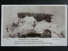 "Greeting: SOMEBODY""S DARLING showing Baby In Crib c1905 RP by Rotary"