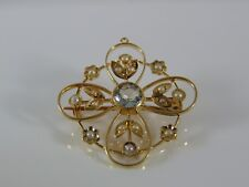 Fine Vintage yellow metal (Tests 9ct) blue Topaz and seeded pearl brooch,4 grams