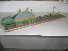 Handbuilt platform section with building, figures and accessories. OO Scale.