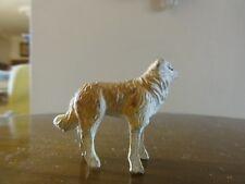 1 santon devineau. 1 chien . 4 cm . pattes en bois