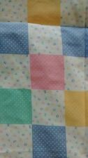 handmade and new baby quilt with pastel and abc squares