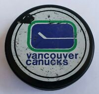 VANCOUVER CANUCKS GAME USED HOCKEY PUCK NHL SPORTS MEMORABILIA OFFICIAL GEAR