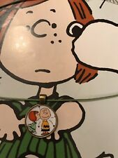 Charlie Brown getting a kiss from Patty olive green adjustable Necklace