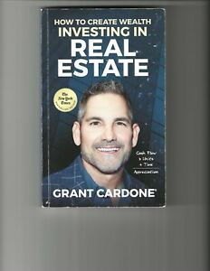 Grant Cardone and family autographed Investing in Real Estate book