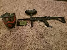 BT4 Combat paintball gun with helmet and hopper.