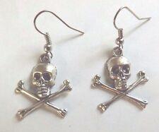 Boucles d'oreilles argentées tête de mort et os