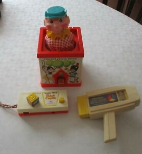 Assorted Retro Fisher Price items.(Jack-in-the-box, camera, movie viewer)
