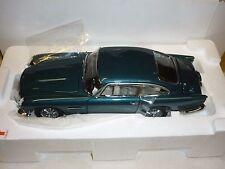 A Danbury mint scale model of a 1965 Aston Martin DB5 Aegean Blue. boxed