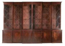 18th century Georgian mahogany breakfront bookcase with shaped crown . Lot 200