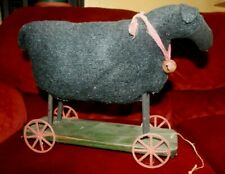 ANTIQUE PRIMITIVE STUFFED BLACK SHEEP ON WHEELS PULL TOY