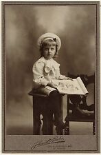 AN ADORABLE CHILD AND A PHOTO BOOK IN ST. LOUIS, MISSOURI  (CABINET CARD)