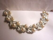 Silver tone bracelet with white enameled leaves an white faux pearls..