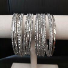19 thin Silver Bangles