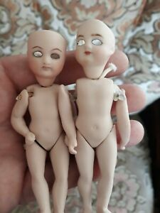 Two Miniature Bisque Dolls  10cm