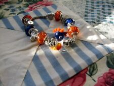 GLASS BIRD BEAD AND OTHER EUROPEAN CHARMS AND BRACELET