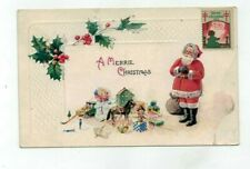 1923 Embossed Christmas Post Card Santa with toys and holly & ivy
