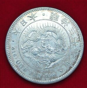 Japan: One Yen Dragon Silver Coin.