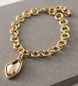 Exclusive Yellow Gold Bracelet With Strikingly Cut Swarovski Crystal Pendant