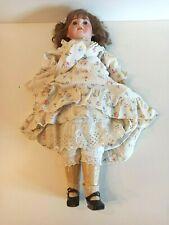 Ancienne poupée tête porcelaine XXème Réf 210