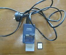 Canon Battery Charger V04484 + battery + sim card VG condition