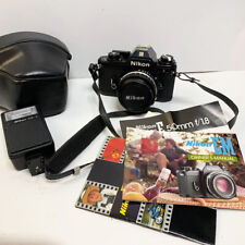 Nikon EM 35mm Film Camera SLR Body 50mm Lens Series E with Flash Manuals & Case