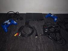 Sony PlayStation 2 Schwarz mit 8 MB Memory Card, 25 Spielen, Lenkrad mit Pedalen