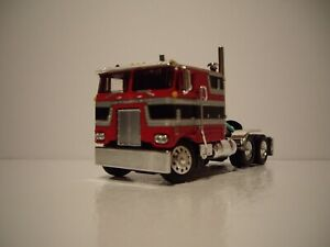 DCP FIRST GEAR 1/64 RED, BLACK AND SILVER PETERBILT 352 WITH 110'' SLEEPER CAB