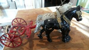 2 Vintage Cast Iron Horses with  Place for Wagon  Toy