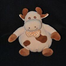 Peluche doudou vache beige JOLLYBABY Priscilla Larsen noeud grelot 16 cm TTBE