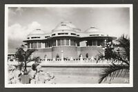 REAL-PHOTO POSTCARD:  INTERESTING BUILDING WITH DOMES - POSSIBLE DESERT CLIMATE