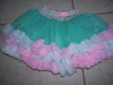 Girls tutu by Tona Michelle size XS , pink, blue green and white, great shape.