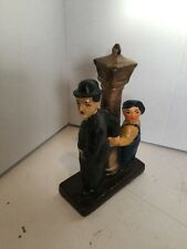 VINTAGE CHARLIE CHAPLIN FIGURINE - LEANING ON LAMP POST WITH CHILD