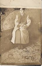 RPPC Lady in lots of clothes in very busy room 11849