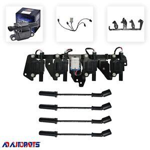 4 Herko B058 Ignition Coils + 4 Herlux Spark Plug Wires + 1 Bracket + 1 Harness