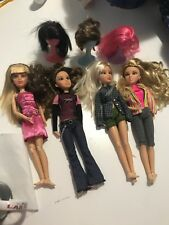 Lot Of 4 Spin Master Liv Dolls Dressed With 3 Wigs and Stands
