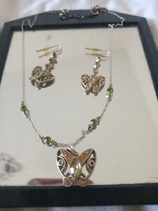 green gemstone costume jewelry necklace and earrings