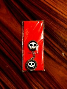 Toy2R Silver Metal Keychain Toyer Skull-Headed Middle Metal Coin Spins