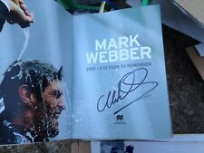 Mark Webber (Australian F1) signed book :  2010 Season to remember + COA